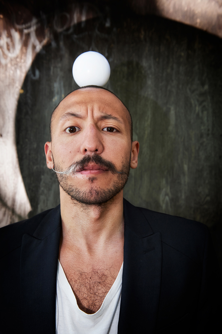 Juggler Jorge Petit two toned mustache and  a ball on his head