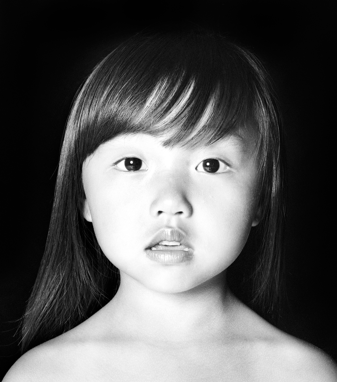 Young Asian girl close up portrait in black and white